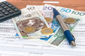 Polish individual tax form pit with money pen and calculator Stock Photos