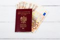 Polish passport with the european currency on boards Royalty Free Stock Images