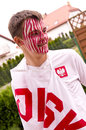 Polish soccer fan half body of or football with painted face and flag Stock Photography