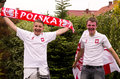 Polish soccer fans two young with flag and scarf Stock Photography