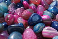 Polished or tumbled gemstones a mixture of in bright pink and blue colors Stock Photo