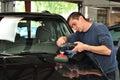 Polishing a car.