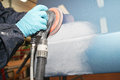 Polishing painter polishs a car body component Stock Image