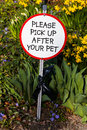 Polite dog shit sign please pick up after your pet Royalty Free Stock Images