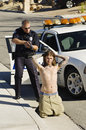 Politieman arresting young man Royalty-vrije Stock Afbeeldingen