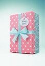 Polka dot gift box with message label Royalty Free Stock Photography