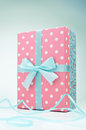 Polka dot gift box with ribbon and bow Royalty Free Stock Photos