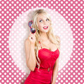 Polka dot pinup girl in retro rockabilly fashion pink woman holding sunglasses Stock Image