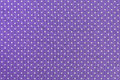 Polka dots fabric purple and white tiny background Stock Image