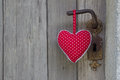 Polka dotted heart shape hanging on door handle handmade woo wooden background or greeting card for wedding valentine s day Stock Images