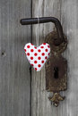 Polka dotted heart shape hanging on door handle handmade woo wooden background or greeting card for wedding valentine s day Royalty Free Stock Photography