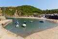 Polkerris harbour cornwall england near st austell and par on a beautiful summer day with blue sea and sky Stock Photography