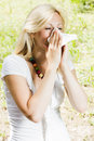 Pollen allergy young woman blowing nose outdoor Stock Image