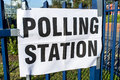 Polling station a sign on a metal fence Royalty Free Stock Image