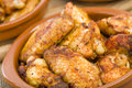 Pollo al ajillo garlic chicken wings traditional spanish tapas dish close up Royalty Free Stock Image