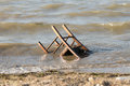 Polluted beach with a chair in it environmental pollution Stock Photos