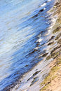 Polluted Water and Beach Stock Image