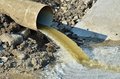 Polluted water overflow industrial pipe pull out from sewage Royalty Free Stock Image