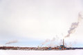 Polluting factory in the snow on an overcast day in green bay wisconsin Stock Images