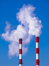 Pollution two smoking chimneys air Stock Image