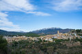 Polop mediterranean village surrounded by snow caped mountains Stock Photos
