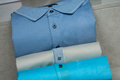 Polos stack in a men fashion store Royalty Free Stock Photo