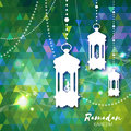 Polygonal green Ramadan Kareem celebration greeting card.