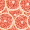 Polygonal vector illustration of a grapefruit slice seamless pattern