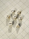 Polyhedral dice on blank roleplay game grid a one inch square map used in roleplaying Stock Photography