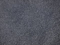 Polymers obtained from scraps of gray color processing waste Stock Photo
