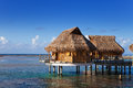 Polynesian landscape typical small houses on water Stock Photos