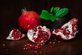 Pomegranate with broken segments, still life Royalty Free Stock Photo