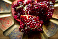 Pomegranate dish very low fields depth Royalty Free Stock Photography