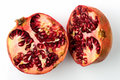 Pomegranate divided in half white background Stock Image