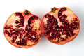 Pomegranate divided in half white background Stock Photo