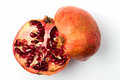 Pomegranate divided in half white background Stock Photos
