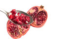 Pomegranate flesh on a spoon Royalty Free Stock Image