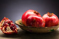 Pomegranate fresh and ripe on the decorative plate Stock Photos