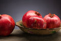 Pomegranate fresh and ripe on the decorative plate Stock Image