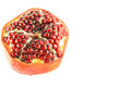 Pomegranate fruit expose seeds with over white background Stock Images