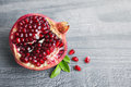 Pomegranate fruit juicy over wooden vintage table Royalty Free Stock Images