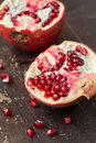 Pomegranate fruit on wooden table Royalty Free Stock Photography