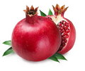 Pomegranate and half of pomegranate on back. Royalty Free Stock Photo