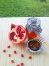 Pomegranate and honey on wood Stock Photos