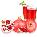 Pomegranate juice in a glass and ripe pomegranate isolated on white background close up studio photography Royalty Free Stock Photos
