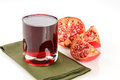 Pomegranate juice on a white background Royalty Free Stock Photography