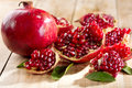 Pomegranate with leafs Royalty Free Stock Photo