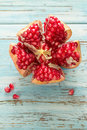 Pomegranate open showing seeds on wooden table Stock Photography