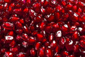 Pomegranate Seeds as red Background Stock Photos