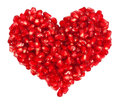 Pomegranate seeds in heart shape isolated on white background Royalty Free Stock Photography
